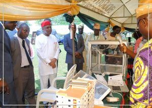 man-president-in-company-of-delegates-from-man-and-federal-poly-ilaro-being-briefed-at-an-exhibition-stand-displayed-by-graduands-of-the-tertiary-institution