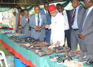 president-of-man-dr-frank-jacobs-mon-inspecting-locally-manufactured-footwears-by-graduands-of-federal-poly-ilaro-during-their-convocation-ceremony
