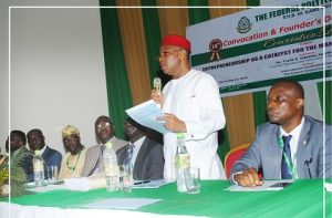 standing-man-president-delivering-a-paper-at-the-convocation-lecture-of-federal-polytechnic-ilaro
