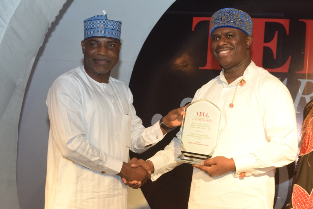 """Vice Chairman, Senate Committee on Marine Transport, Senator Ahmed Ogembe presenting the Award to the Director General, Nigerian Maritime Administration and Safety Agency (NIMASA) Dr. Dakuku Peterside during the Tell Awards of Excellence, 2016, held at the Civic Centre, Victoria Island, Lagos where NIMASA bagged """"Public Organisation of the Year""""."""