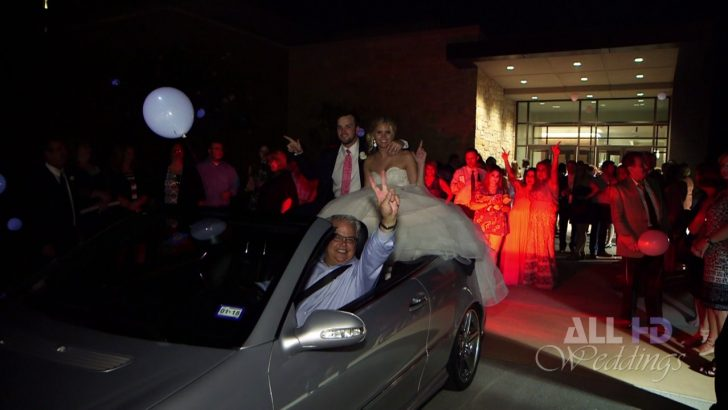 Bride and groom fall off back of luxury car