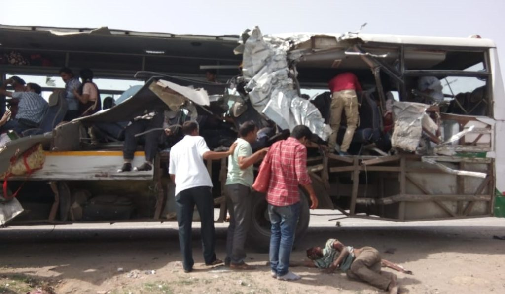 13 die as passenger bus collides with truck