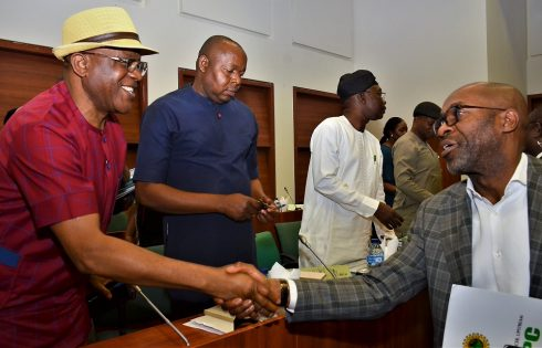 Representative of NNPC GMD and NNPC Chief Operating Officer, Upstream, Mr. Roland Ewubare (right), exchanging pleasantries with the Chairman of the house of Representatives Committee on Environment and Habitat, Hon. Johnson Oghuma (left) at an investigative hearing by the committee on the Ogoniland Clean-up Project in the National Assembly, Abuja… Monday.